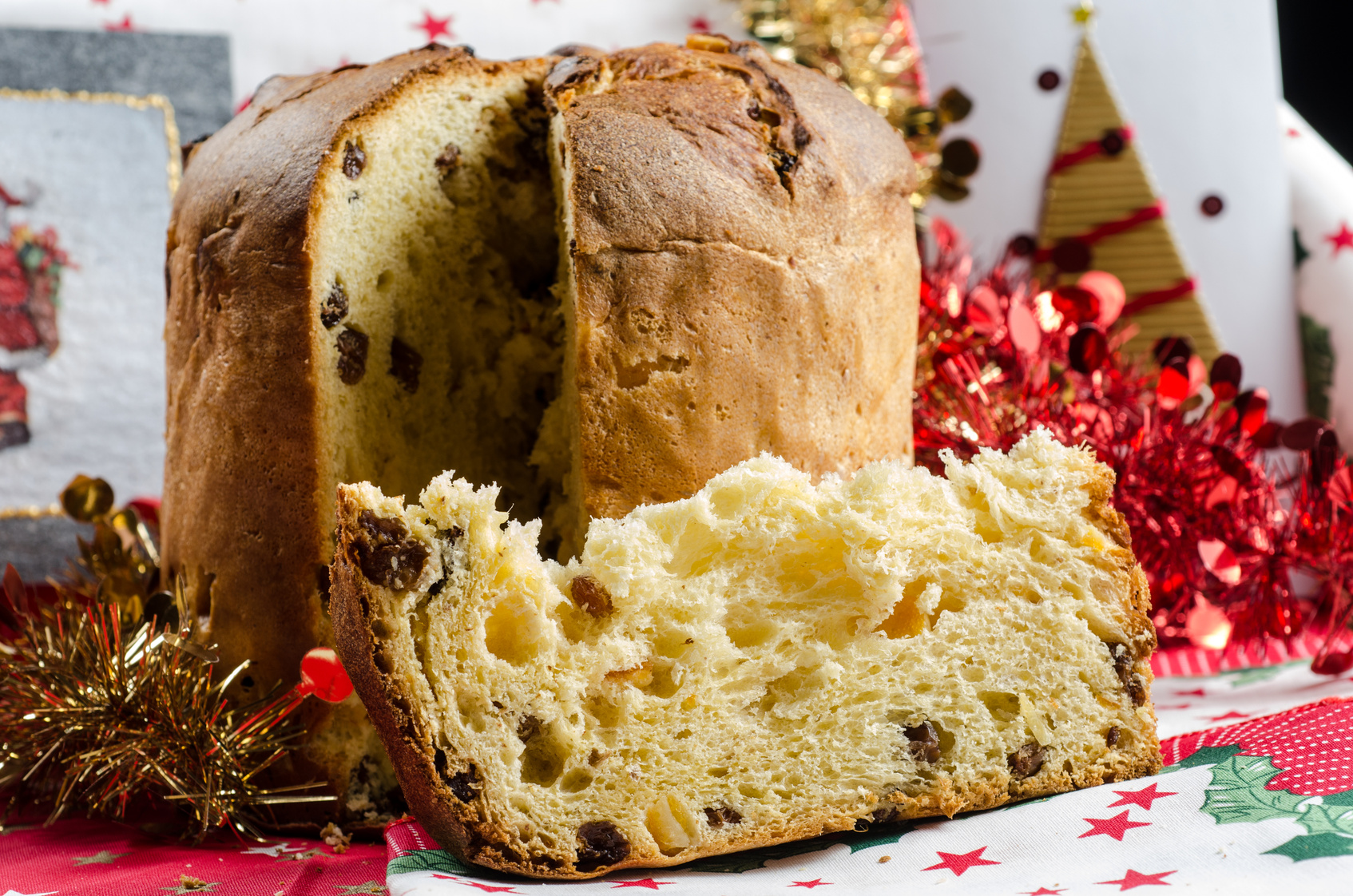 "Christmas italian cake called ""panettone"" on traditional dinner table with decorations"