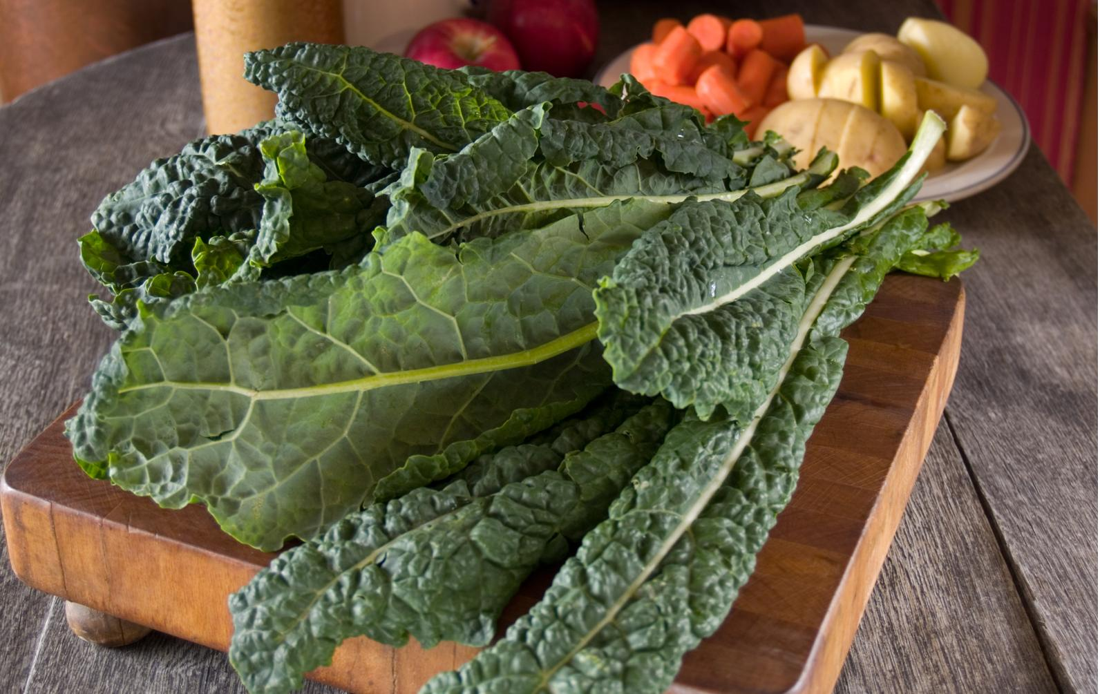 Lacinato kale on a wooden cutting board