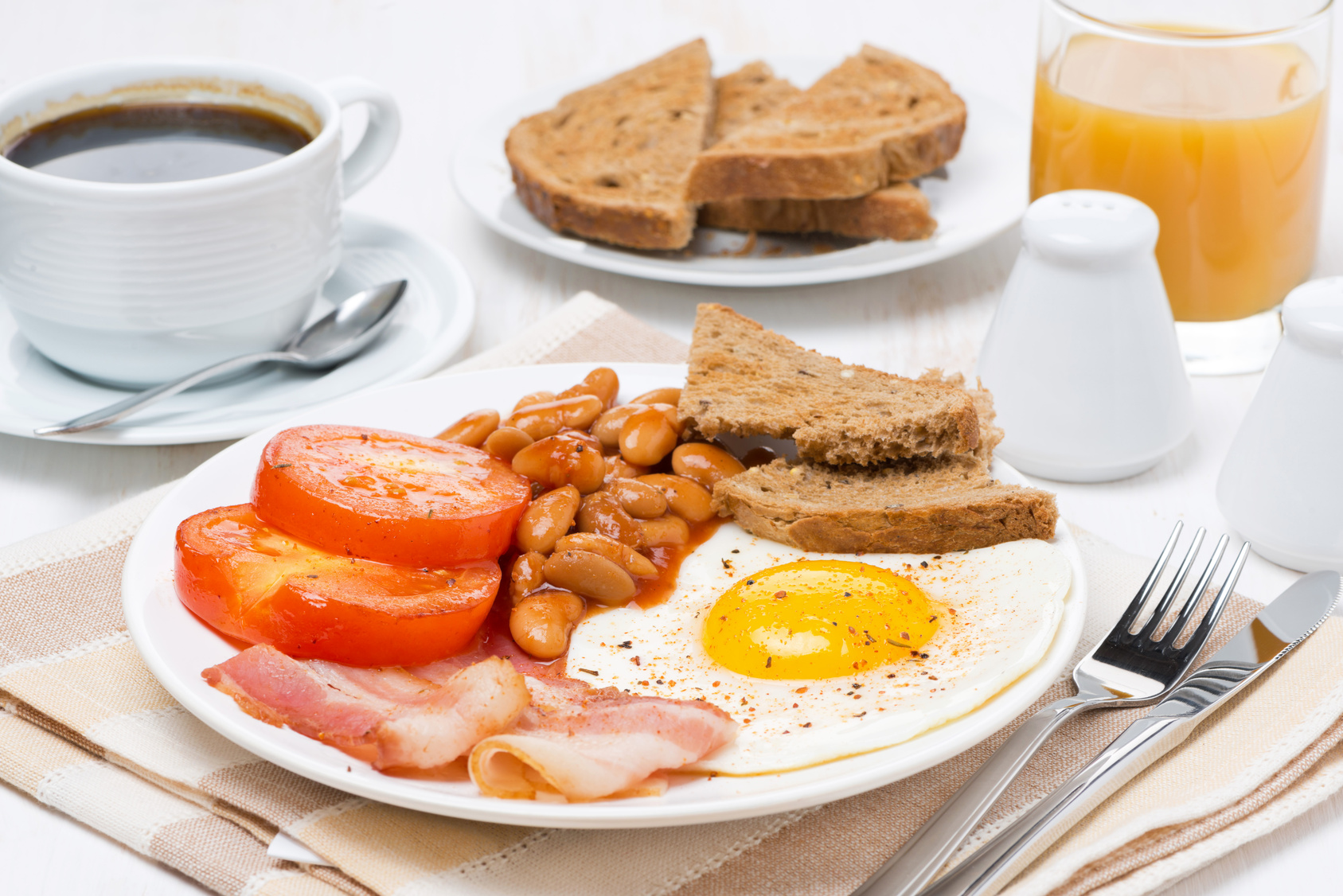 English breakfast with fried eggs, bacon and beans