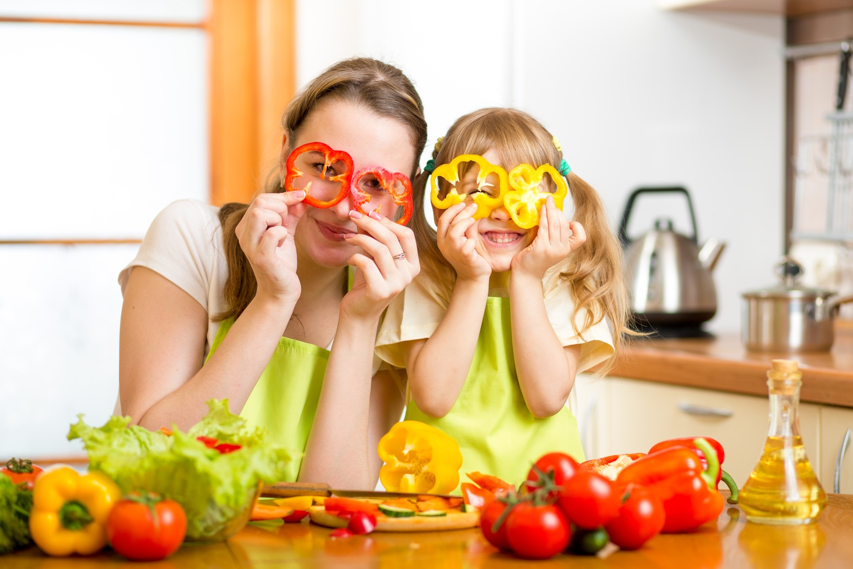 mother and kid preparing healthy food and having fun
