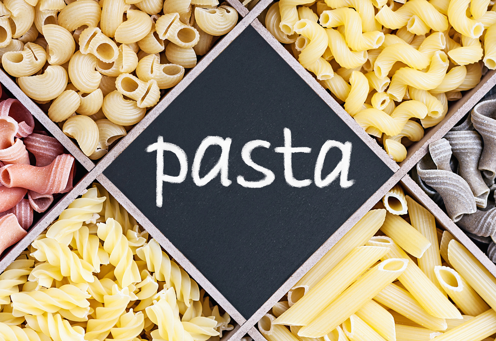 pasta assortment and blackboard with text